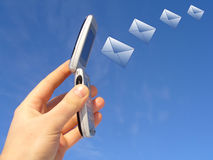 Email being sent by a wireless device. Conceptual image of email  being sent by a hand held mobile device Royalty Free Stock Photos