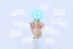 Email. Businessman is pressing the Email button on the transparent screen Stock Images
