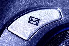 Email button. Macro of an email button on keyboard - in blue light Royalty Free Stock Photos