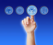 Email concept. Finger pressing the email icon on blue background Royalty Free Stock Photos