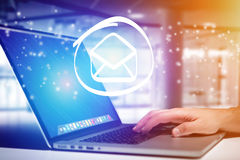 Email icon going out a laptop interface - technology concept. View of a Email icon going out a laptop interface - technology concept Royalty Free Stock Photography