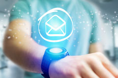 Email icon going out a smartwatch interface - technology concept Stock Photography