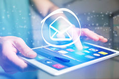 Email icon going out a tablet interface - technology concept Royalty Free Stock Images