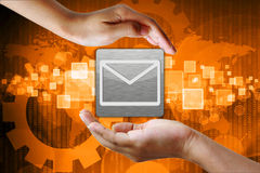 Email icon in hand Royalty Free Stock Images