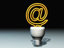 Email lamp concept. Abstract of the bottom of a light bulb, with the @ symbol in yellow extending from the top Royalty Free Stock Photos