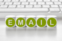 Email. Letter dice in front of a keyboard - Email royalty free stock images