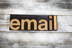 Email Letterpress Word on Wooden Background. The word `email` written in wooden letterpress type on a white washed old wooden boards background Royalty Free Stock Images