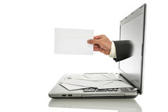 Email. Male hand coming out of laptop monitor offering you an envelope. over white background royalty free stock image