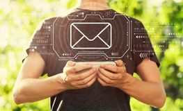 Email with man holding his smartphone royalty free stock images