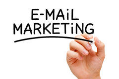 Email Marketing. Hand writing E-mail Marketing with black marker on transparent wipe board Stock Image