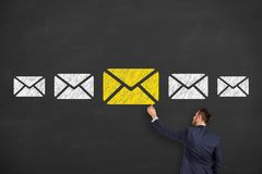 Email marketing newsletter and bulk mail concepts on Blackboard. Working Royalty Free Stock Photography