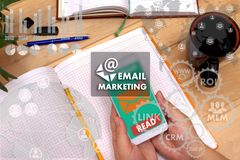 EMAIL MARKETING on the touch screen to the network, on office bl stock images
