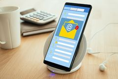 Email notification. New email notification on mobile phone , smartphone screen with new unread e-mail message and read mail, Mail Communication Connection stock photos