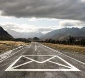 Email sign on asphalt road Royalty Free Stock Image