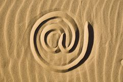 Email sign drawn in the sand Stock Photography