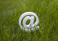 Email sign on green grass Royalty Free Stock Image