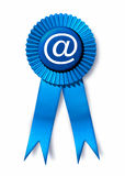 Email symbol with blue ribbon award Stock Images