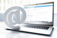 Email symbol on business laptop computer royalty free stock image