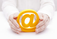 Email symbol protected by hands stock image