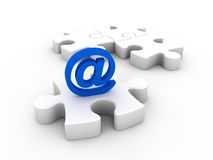 Email symbol and puzzle Royalty Free Stock Photo