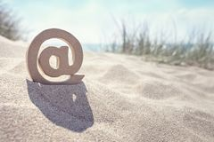 E-mail @ symbol at the beach Stock Images