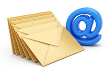Email symbol and stack of envelopes Royalty Free Stock Photos