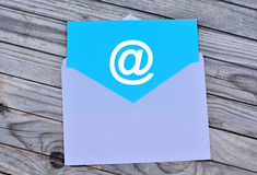 Email symbol in white envelope Royalty Free Stock Photos