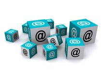 Email symbols on cubes. Email @ symbols on blue and white cubes against a white background Stock Photos