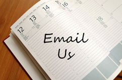 Email us write on notebook. Email us text concept write on notebook stock photos