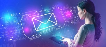 Email with woman using a tablet stock images