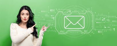 Email with young woman. Pointing on a green background royalty free stock images