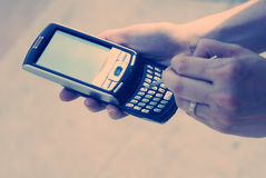 Emailing a client with pda device. Cross processed Stock Images