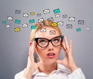 Emails with business woman. On a gray background Stock Images