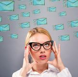 Emails with business woman. On a gray background Royalty Free Stock Photos