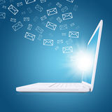 Emails fly out of laptop screen Royalty Free Stock Image