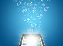 Emails fly out of smartphone screen Royalty Free Stock Photo