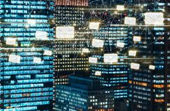 Emails with skyscrapers illuminated at night Royalty Free Stock Photos