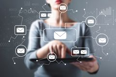 Emails with woman using a tablet. Emails with business woman using a tablet computer royalty free stock photos
