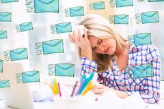 Emails with woman with crumpled paper balls. Emails with young woman with crumpled paper balls royalty free stock photo