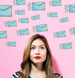Emails with young woman Stock Image