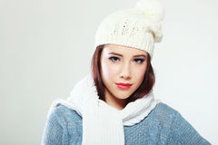 Emale model wearing a blue woolen sweater. Beautiful smiling mixed rase caucasian/asian female model wearing a blue woolen sweater Stock Photography
