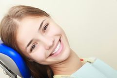 Emale patient smiling in dentistry. Portrait of female patient smiling in dentistry Royalty Free Stock Photos
