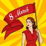Emancipated woman holds a red placard. Feminism rally. International Women`s Day pop art retro style. Emancipated woman holds a red placard. Feminism rally Stock Images