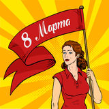 Emancipated woman holds a red placard. Feminism rally. International Women`s Day pop art retro style. Emancipated woman holds a red placard. Feminism rally Royalty Free Stock Photography