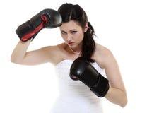 Emancipation idea. Bride in wedding dress boxing gloves. Emancipation idea concept. Bride in wedding dress wearing boxing gloves. Woman showing her power royalty free stock photo