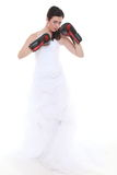 Emancipation idea. Bride in wedding dress boxing gloves. Stock Photo