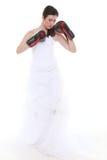 Emancipation idea. Bride in wedding dress boxing gloves. Emancipation idea concept. Bride in wedding dress wearing boxing gloves. Woman showing her power stock photo