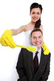Emancipation idea. Woman brushing teeth of her man, humor. Emancipation idea concept. Humorous funny wedding couple bride and groom - women brushing teeth of her royalty free stock photography