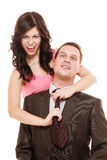 Emancipation. Woman pulling tie of man. Domination. Emancipation. Humorous funny elegant couple isolated. Woman pulling the tie of man, girlfriend showing her stock photography