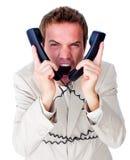 Emaranhado forçado do homem de negócios acima em fios do telefone foto de stock